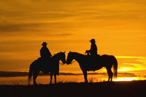 Cowboys on ridge at Sunset; Model Released by Danita Delimont