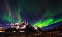 Aurora borealis above Mt Store Nappstind in Lofoten islands by Stein Liland