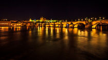 Night view of Prague castle and Charles Bridge by Zoltan Duray
