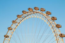 The London Eye against a cold blue winter sky by Chris Warham