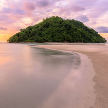Tropical island and paradise beach at sunset by Juhani Viitanen