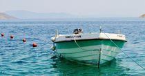 Boat at Symi island by atelierpositif