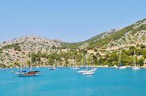 Boats at Symi island by atelierpositif