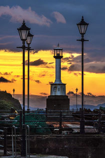 'Maryport Lighthouse At Sunset' by Ian Lewis