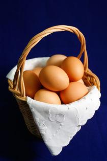 Eggs in a basket by Gaspar Avila
