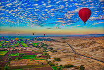 Hot Air Balloon at Sunrise in over Ruins in Luxor Egypt by Andy Doyle