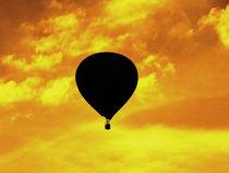 Balloon to gold sky by Stefan Herkenrath