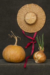 Still life with pumpkin, hat and sprouted onions by Valentin Ivantsov