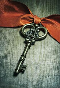 Ornamented key with red ribbon by Jarek Blaminsky