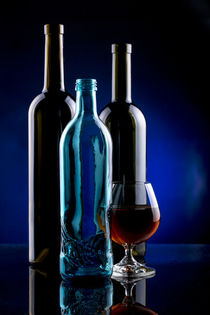 Still life with a glass bottle and a glass by Valentin Ivantsov