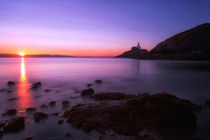 Sunrise at Mumbles lighthouse by Leighton Collins