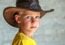 Young Blond Boy With LederHat by Eveline Toplak