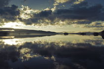 Towering clouds are reflected in a glassy lake at sunset von Intensivelight Panorama-Edition