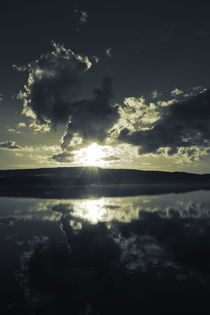 The sun is setting behind the hilly shore of a smooth forest lake - duotone by Intensivelight Panorama-Edition
