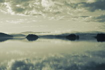 The cloudy sky is reflected in a glassy lake - duotone by Intensivelight Panorama-Edition