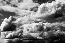 Dramatic Cumulus clouds with vertical growth by Jim Corwin