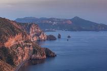 Coastline of island Lipari with view to volcan island Vulcano during sunset, Sicily Italy von Bastian Linder