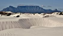 a white sand dune and Table Mountain  by Werner Lehmann
