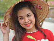 Smiling Vietnamese Woman with Asian Conical Hat by Matt Hahnewald