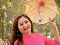Smiling Vietnamese Woman with Asian Conical Hat (01) von Matt Hahnewald