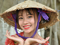 Smiling Vietnamese Girl with Traditional Asian Conical Hat by Matt Hahnewald