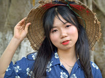 Vietnamese Girl with Asian Conical Hat  by Matt Hahnewald