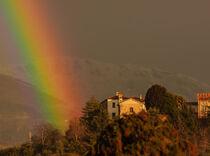 a colorful rainbow arch drawn in the sky by susanna mattioda
