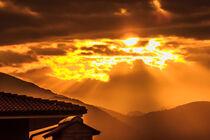 a golden sunset of threatening clouds  von susanna mattioda