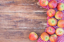 Red apples on rustic wooden table, top view, copy space by Alex Winter