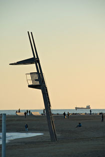 Barcelona's beach at twilight  by Thierry  Dehesdin
