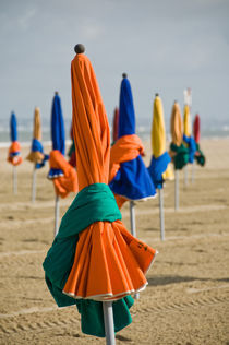 The Deauville's parasols at low tide  by Thierry  Dehesdin