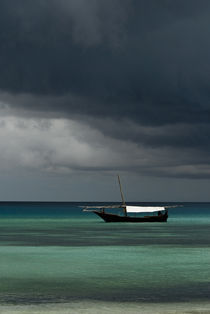 Dhow Boat Under Stormy Skies by Russell Bevan Photography