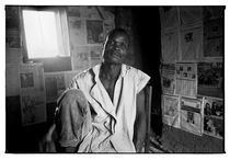 Man with newspapers on the walls by Jan Wolak-Dyszynski