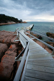Pier winding to the sea at dusk - Freycinet, Australia by Jess Gibbs