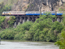 Train Along Cliff Over River by James Menges