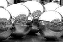 reflection on silver balls by Ricardo Anderson
