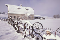 NA, USA, Washington, Uniontown White barn and wheel fence in snow of winter PR by Danita Delimont
