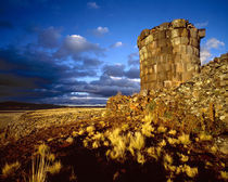 South America, Peru, near Lake Titicaca. Ancient Inca tomb at sunset. Credit as von Danita Delimont