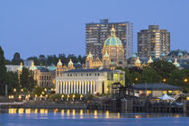 The Parliament Buliding lit up at the inner harbour at Victoria British Columbia by Danita Delimont