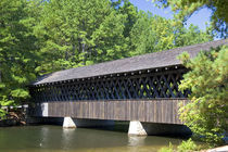 The Stone Mountain Covered Bridge at Stone Mountain Park, Georgia. by Danita Delimont