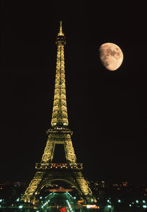 Europe, France, Paris. Eiffel Tower at night with moon. Credit as by Danita Delimont