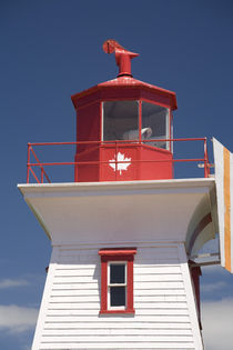 Canada, Prince Edward Island, Victoria. Lighthouse with Maple leaf. by Danita Delimont