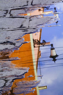 Mexico, San Miguel de Allende, Lantern reflection in puddle. Credit as