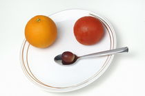 Plate and spoon with one Orange, one tomatoe, one grape, on white background by Sami Sarkis Photography