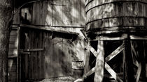 Wooden Barn and Water Tower by Graham Hughes