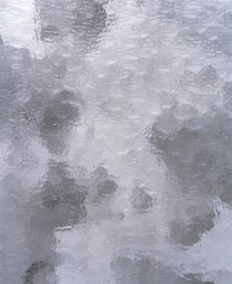 Close up of light grey and white wispy stained glass by Panoramic Images