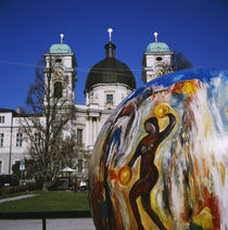 Painted sphere in front of a church, Dreifaltigkeitskirche II, Salzburg, Austria by Panoramic Images