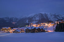 Buildings lit up at dusk, Courchevel, French Alps, France by Panoramic Images