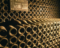 Close-up of wine bottles in a cellar of Bollinger, Ay, Champagne, France von Panoramic Images