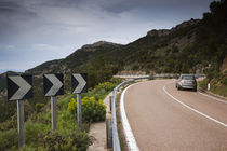 Car on the road, Genna Silana Pass, Gennargentu Mountains, Sardinia, Italy by Panoramic Images